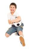 Мальчик футбола с студией шарика изолировал белую предпосылку Стоковая Фотография