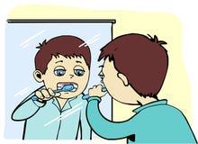 мальчик чистя его зубы щеткой Стоковые Изображения