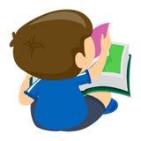 Мальчик читая книгу назад осматривает Стоковая Фотография RF