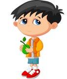 Мальчик шаржа держа зеленый плодоовощ Стоковое Фото