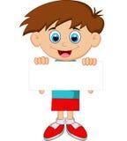 Мальчик шаржа держа чистый лист бумаги Стоковое фото RF
