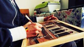 Мальчик paiting Стоковая Фотография