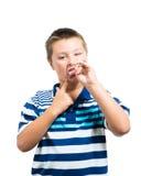 Мальчик Preteen делая выражения лица Стоковые Изображения