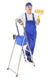 Маляр с лестницей на белизне стоковая фотография