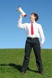 мегафон бизнесмена используя Стоковое Изображение RF
