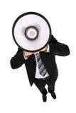 мегафон бизнесмена используя Стоковые Изображения