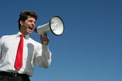 мегафон бизнесмена стоковое изображение