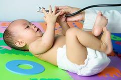 медицинское соревнование младенца Стоковое Изображение