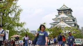 Международные туристы sightseeing на Осака рокируют, Япония акции видеоматериалы
