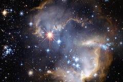 Межзвёздные облака и много звезд в космическом пространстве Элементы этого изображения поставленные NASA стоковое фото