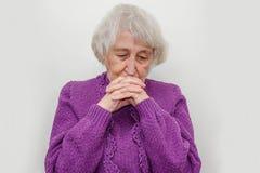 Меланхоличная старшая женщина Стоковая Фотография