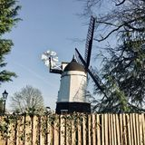 Мельница ветра на ферме Стоковая Фотография