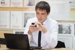 Менеджер в офисе стоковое фото rf