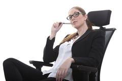 Менеджер в стуле офиса стоковое фото rf