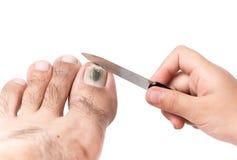 Меньшая польза руки пилочка для ногтей очистить toenail стоковые фотографии rf