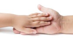 Меньшее касание руки на изолированной руке отца Стоковая Фотография