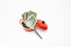 Меньшее красное cocotte вполне долларов стоковая фотография