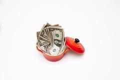 Меньшее красное cocotte вполне долларов стоковое фото rf