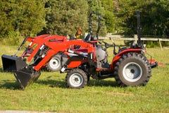 меньшие красные тракторы 2 сбывания Стоковое Изображение RF