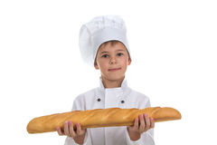 Меньший мальчик кашевара с хлебом белизна изолированная предпосылкой стоковые фотографии rf