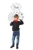 Меньший думать мальчика дела стоковые фото