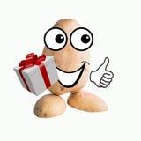 Меньший человек картошки с подарком Стоковая Фотография RF