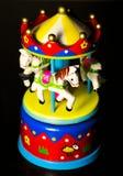 Меньший carousel игрушки веселый идет лошади круга Стоковая Фотография