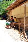 Местные мальчики отдыхая от солнца после полудня Стоковое фото RF