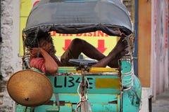 Местный водитель trishaw в Yogjyakarta Стоковое Фото