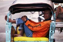 Местный водитель trishaw в Yogjyakarta Стоковая Фотография