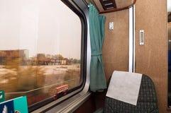 Место пассажирского поезда и запачканный взгляд окна Стоковые Изображения RF
