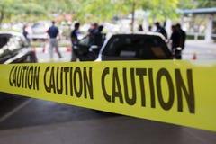 Место преступления защищает лентой предосторежения Стоковая Фотография