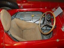 Место старой красной автомобильной формулы 1 Стоковые Изображения