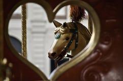 Место Carousel с сердцем и лошадью стоковая фотография