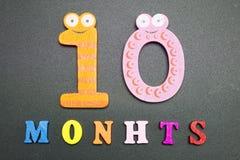 10 месяцев на черной предпосылке Стоковые Фотографии RF