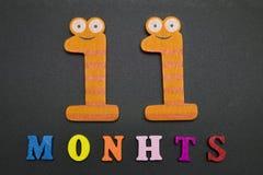 11 месяцев на черной предпосылке Стоковые Изображения RF