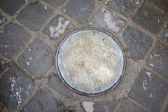 Металлический люк города стоковое фото