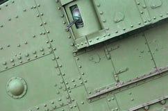 Металл зеленого цвета конспекта промышленный текстурировал предпосылку с заклепками и болтами стоковые изображения rf