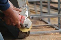 Металл с точильщиком, работник sawing работника сваривая сталь, версию 12 Стоковые Изображения RF