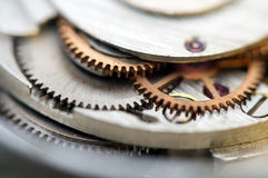 Металлическая предпосылка с cogwheels металла clockwork Макрос Стоковая Фотография