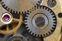 Металлическая предпосылка с cogwheels металла clockwork Макрос Стоковые Изображения