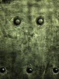 Металлическая пластина Grunge зеленая заклепывает текстуру предпосылки винтов Стоковые Фото