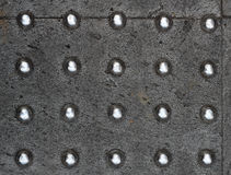 Металлические точки над конкретной текстурой Стоковое Фото