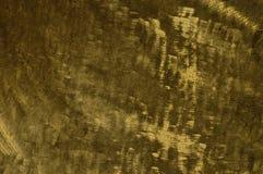 Металл концепции предпосылки обоев яркого блеска текстуры золота Стоковое Изображение