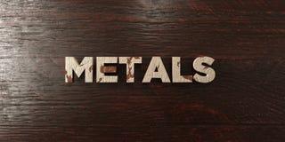 Металлы - grungy деревянный заголовок на клене - представленное 3D изображение неизрасходованного запаса королевской власти иллюстрация штока