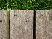 Металл Shinny ногти на деревянном поле Стоковые Фотографии RF