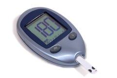 метр глюкозы крови Стоковая Фотография