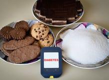 Метр, печенья и сахар глюкозы Стоковая Фотография
