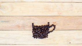 Механизм прерывного действия вида кофейного зерна как кофейная чашка сток-видео