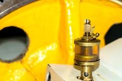 Механизм смазчика в мастерской Стоковая Фотография